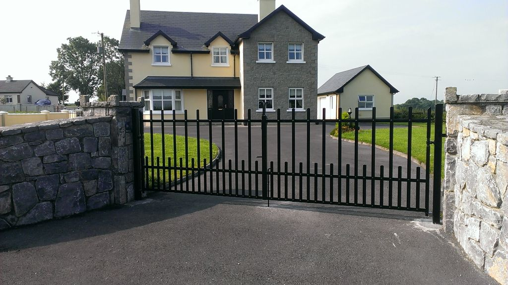 Pair of gates with half pales and decorative centre scrolls, finished in black, New Inn, Co Galway.