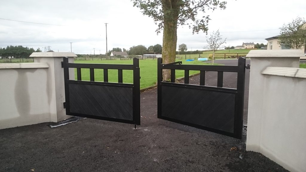 Pair of gates with recycled plastic boards, 'Belcarra style'. A modern take on a wooden gate but low maintenance. Finished in black with tongued and grooved recycled plastic, Adare, Co Limerick.