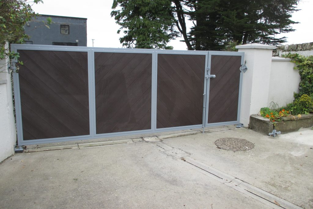 Entrance gate with pedestrian gate, brown tongued and grooved plastic, frame galvanised and finished in grey, New Ross, Co. Wexford